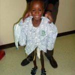 Little J., victim of an accidental gunshot, after his second surgery